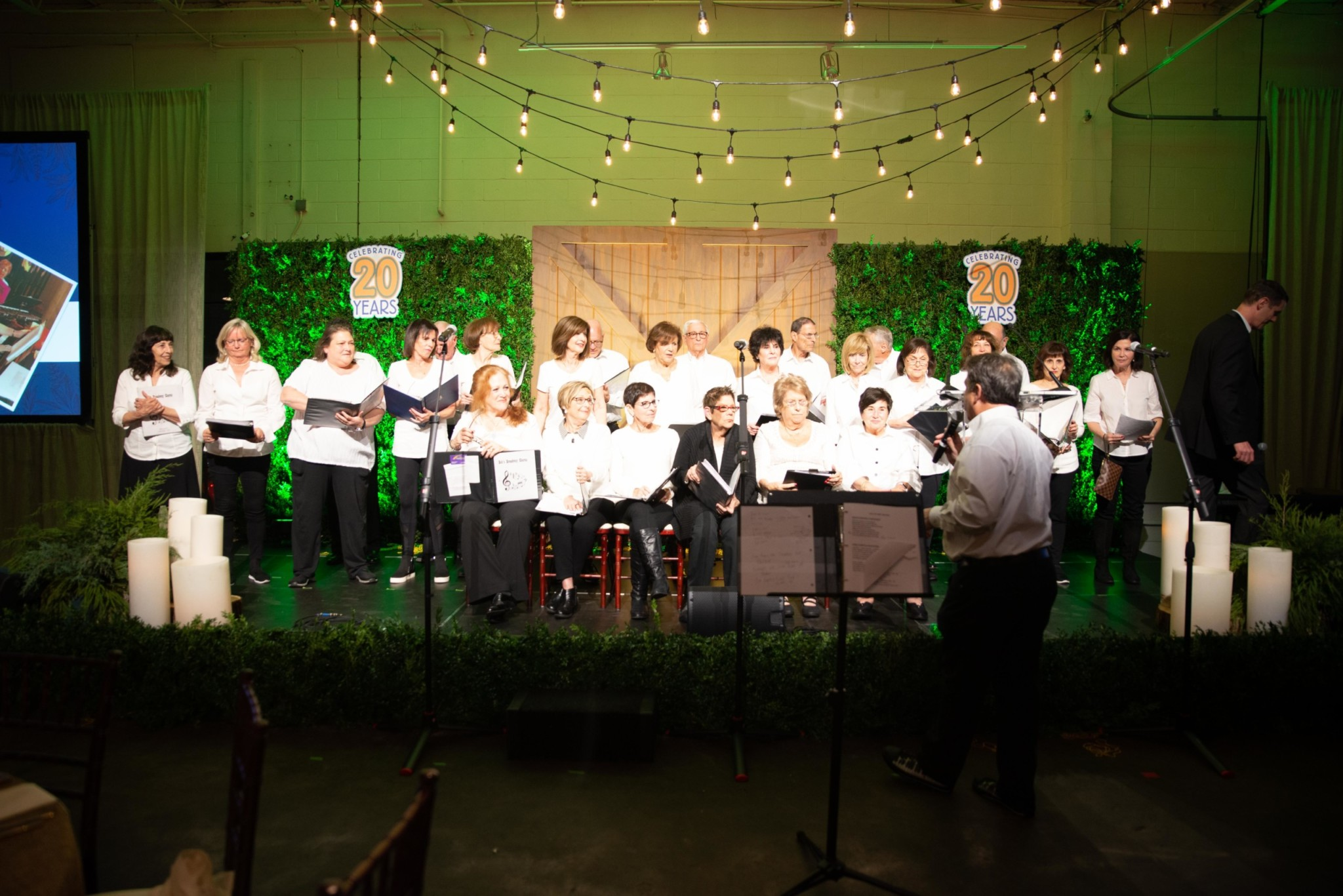 Choir on stage signing at a Camp Kudzu event